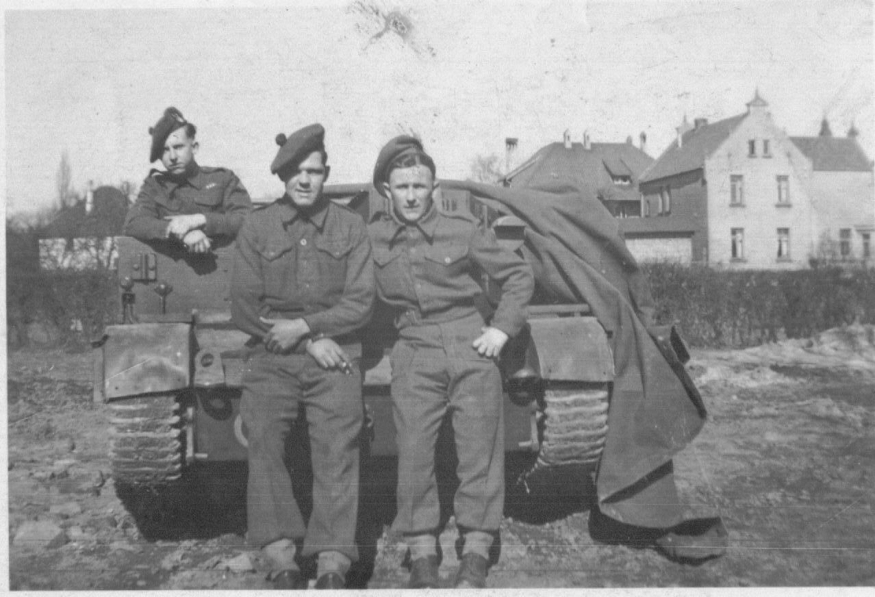 Dad, Bren carrier and cohorts, somewhere in germany..jpg